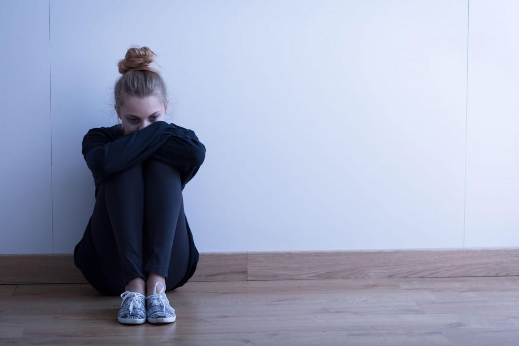 Moody Girl Sitting on Floor